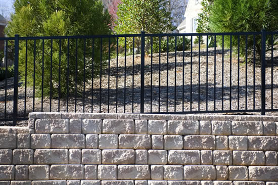 Ornamental Aluminum fence and retaining wall
